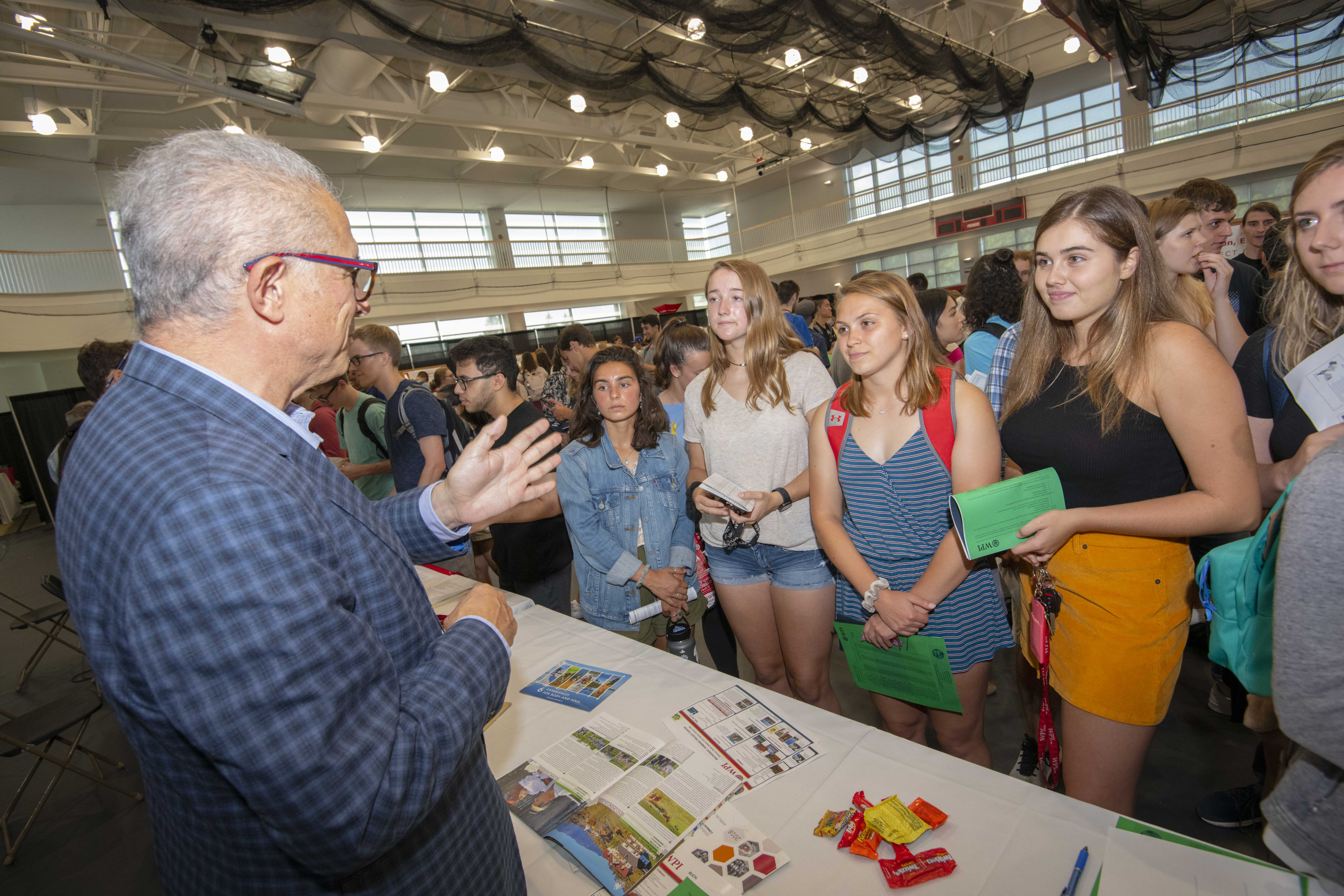 Students discuss a project center location with Vice Provost for Research, Bogdan Vernescu.