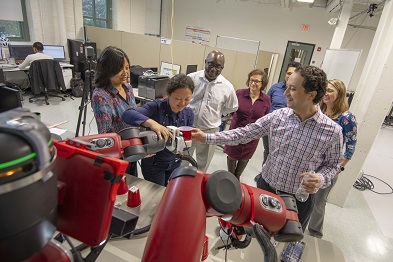 WPI researchers conduct a gripping-related experiment with the Baxter robot. alt