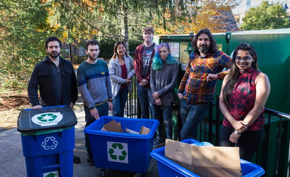 WPI Assistant Professor Berk Calli will work with students on a project to develop robotics technologies for recycling centers. From left, James Akl, Fadi  Alladkani, Arianna Kan, Kyle Heavey, Mikayla Fischler, Calli and Snehal Dikhale. alt