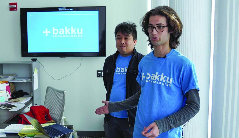WPI students presenting invention alt