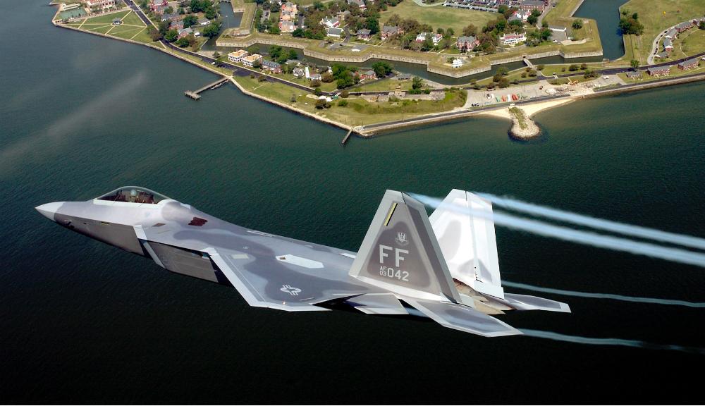 F-22 Raptor flying over ocean