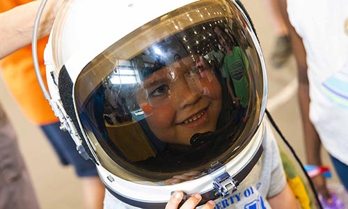 Child in astronaut helmet at WPI's TouchTomorrow STEM festival
