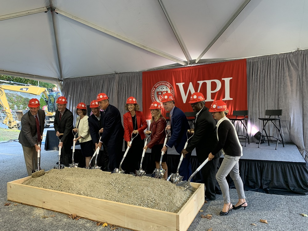 Laurie Leshin, joined by WPI staff, trustees, deans, and other members of the community, gather to break ground on WPI's newest building.