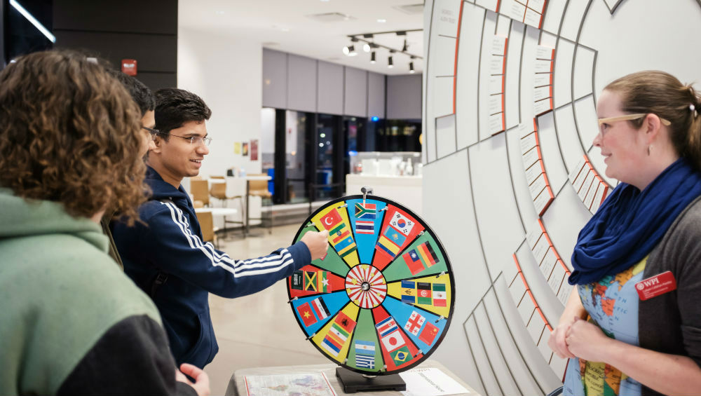 Students spin a wheel of different cultures