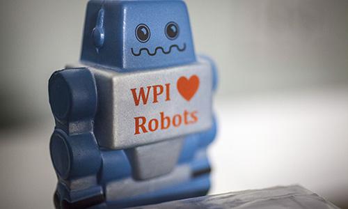 WPI loves Robotics, robot figurine.