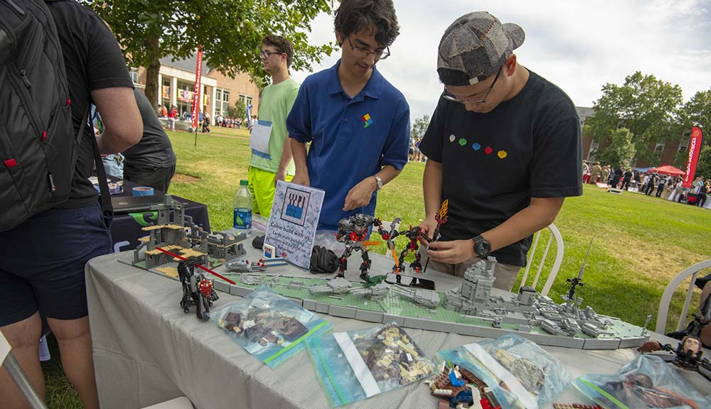 Two members of the LEGO Club construct pieces during this year's Activities Fair.