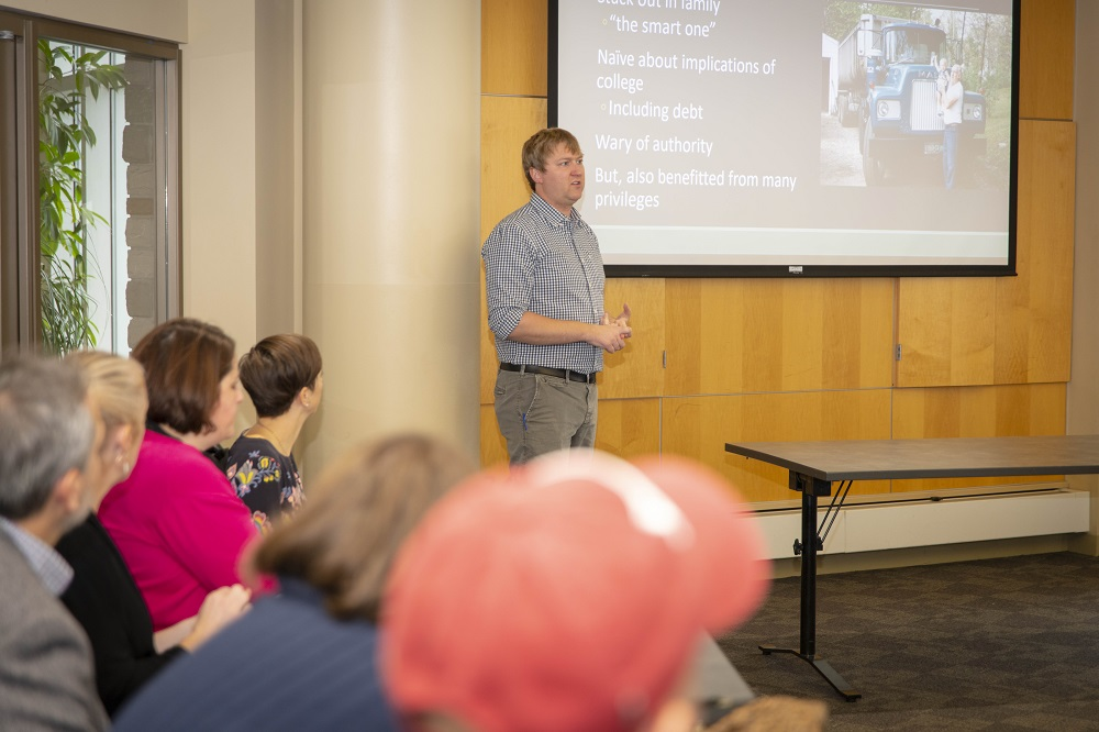 Guest Speaker Colby King talks with faculty and staff about supporting first-generation working class students.