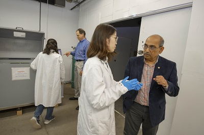 Co-principal investigator Brajendra Mishra (right, foreground) confers with PhD student Qingli Ding.  alt