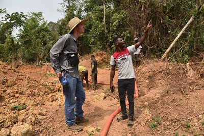 Van Harting '20 speaks with a miner about water use and mercury contamination in Ghana. alt