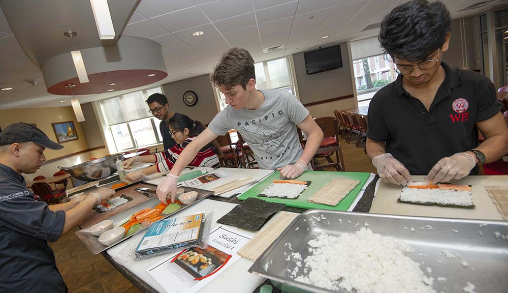 Students participate in a sushi-making class as part of WinterSession.