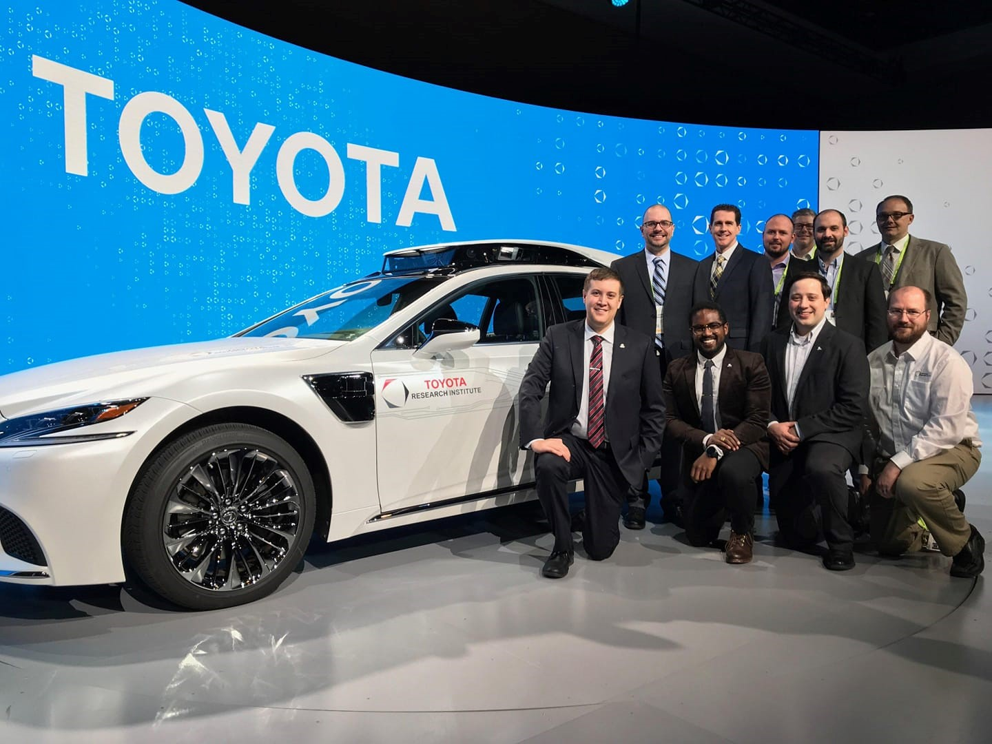 A team at Toyota Research Institute poses with a car design