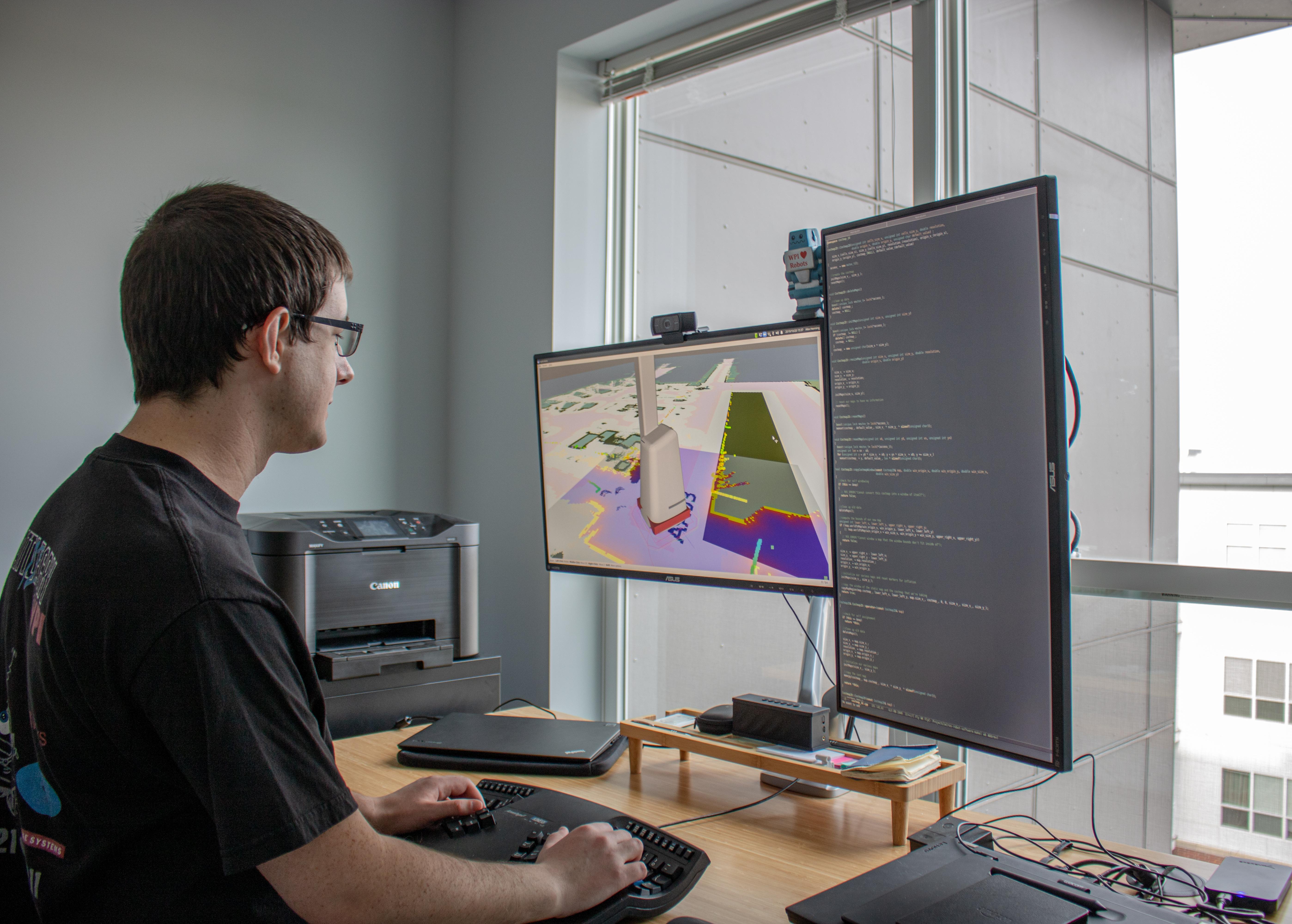 A former Robotics Engineering major working on his computer