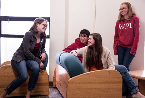 Students sitting down in a common room conversating