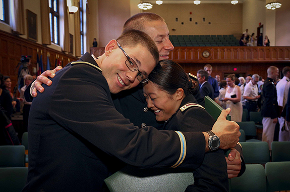 ROTC students hugging during commencement alt