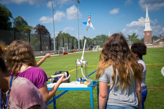 Children Launching Toy Rockets