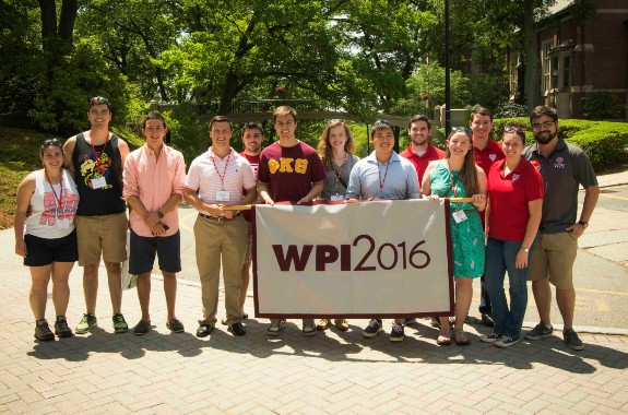 students holding class of 2016 alumni weekend banner