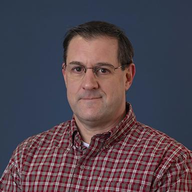 Headshot of title IX coordinator John Stewart