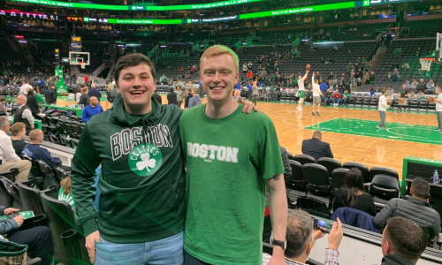 Christoper Tracy, Chemical Engineering Student, with a friend at a Celtics basketball game