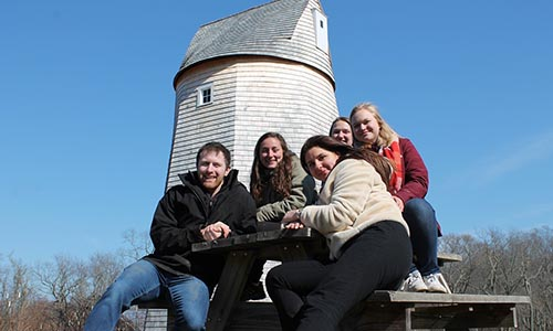 WPI students standing in front of windmill