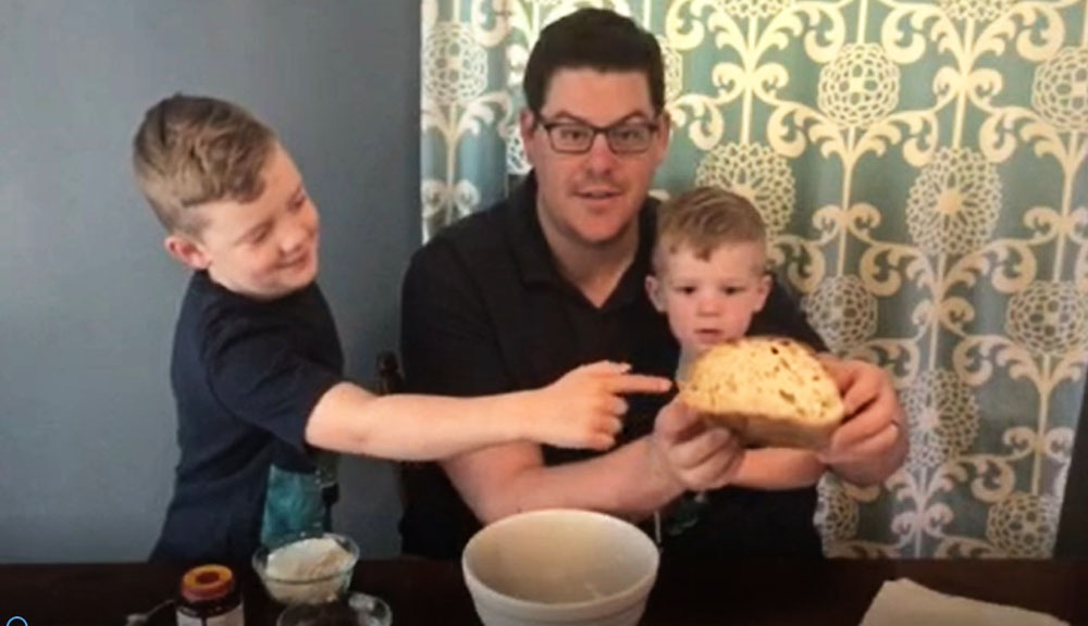Chemical engineer Eric Young bakes with his children.