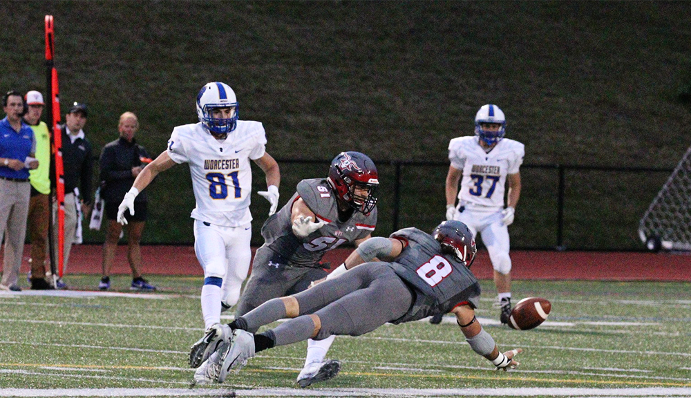 WPI Engineer and conference Defensive Athlete of The Year Sam Casey (#8) dives for the ball.