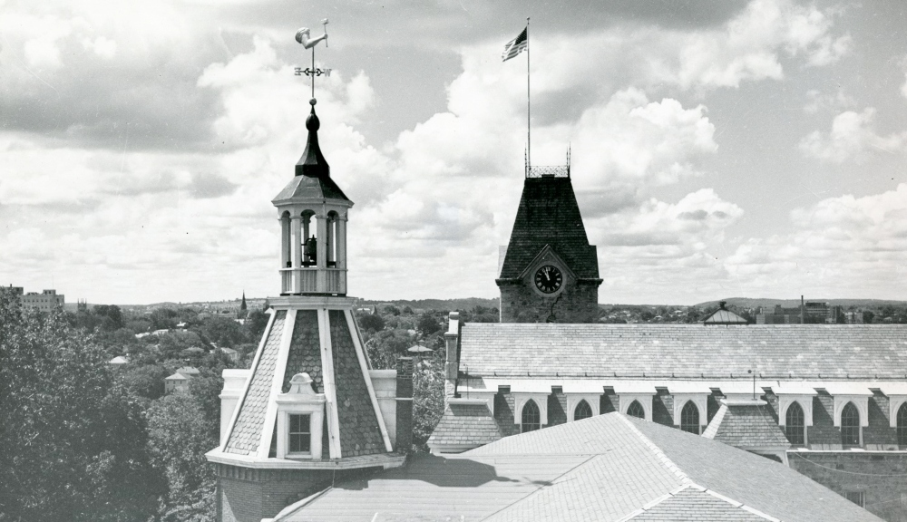 A black and white photo of the two towers on WPI's campus, Boynton and Washburn.