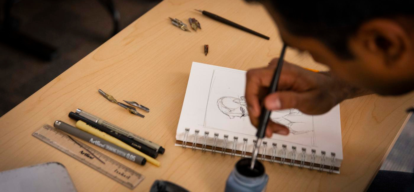 A student designs a character for his IMGD project