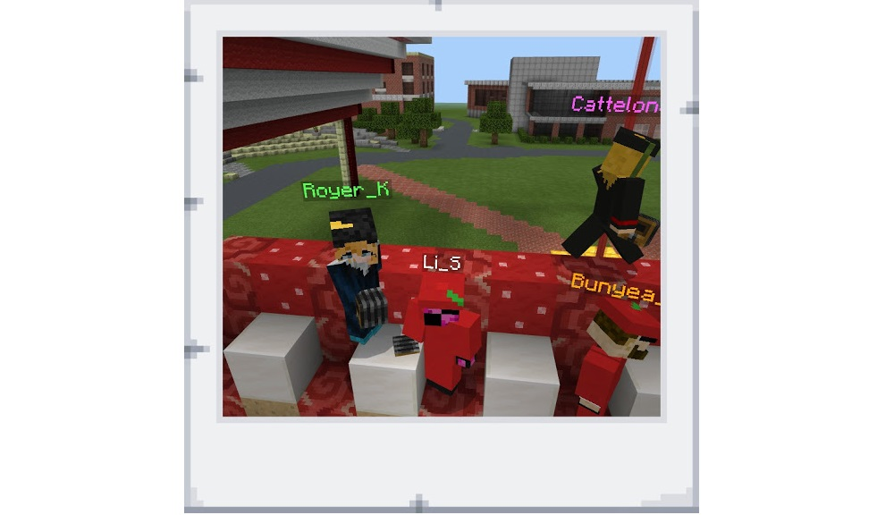 Student avatars cheer on their fellow graduates during the Minecraft commencement.