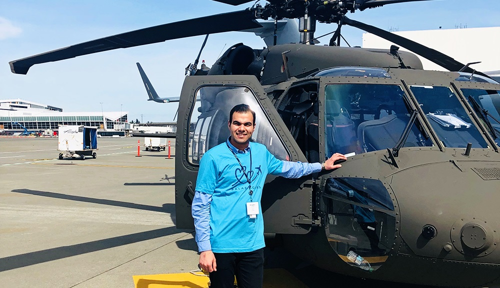 Abdullah with Boeing aircraft during his internship with the company.