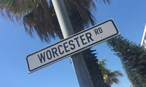 """A street sign reading """"Worcester Rd"""" in South Africa."""