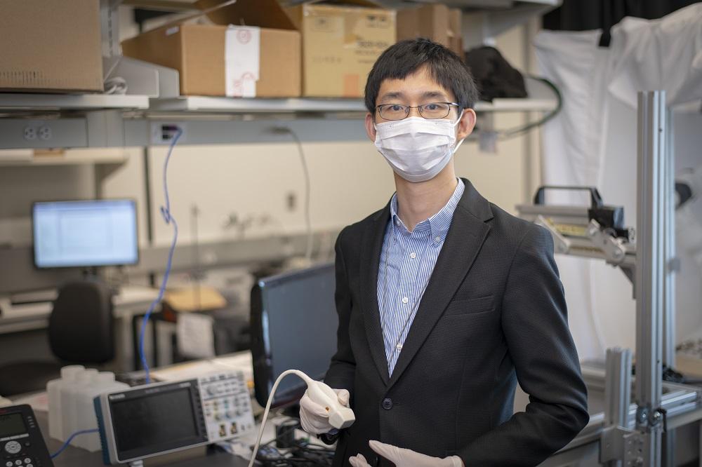 Haichong Zhang in his laboratory.
