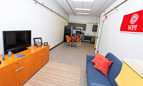 Home Health Suite - Room with a couch, tv, kitchen and table
