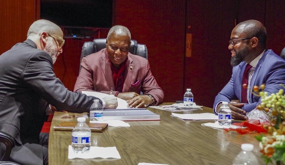 three men at a table