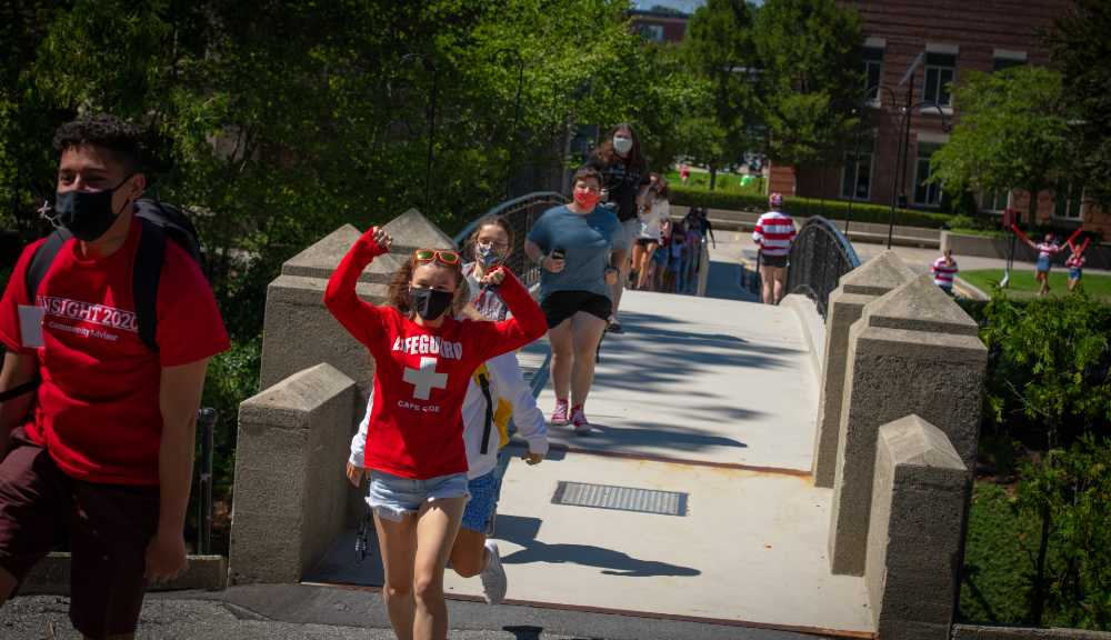 Students cross Earle Bridge during this year's bridge crossing tradition.