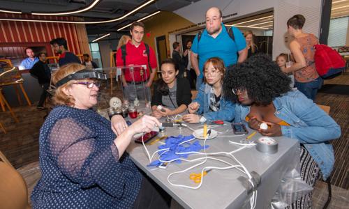 Studnets observing a science demonstration during Arts & Sciences Week