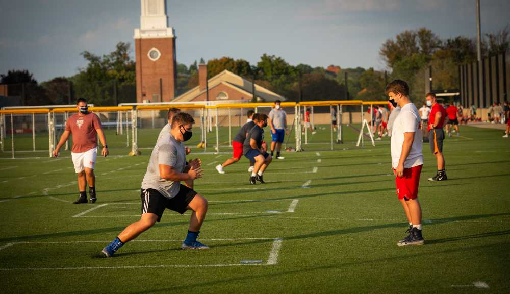 Members of the WPI football team participate in a socially distanced conditioning practice on the rooftop field.