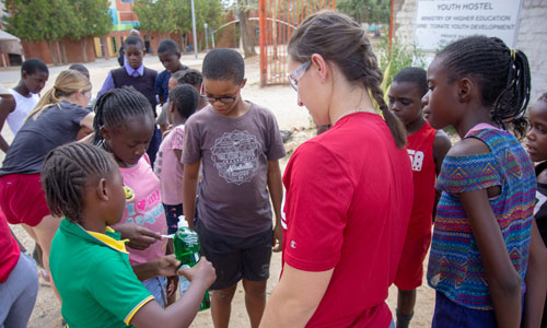 WPI Student working with young children around the world