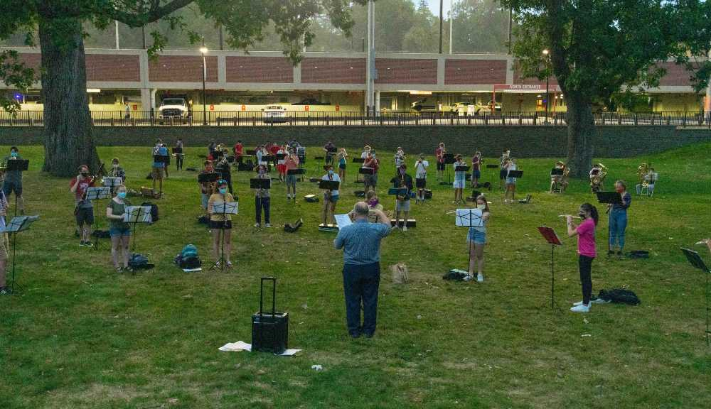 A photo of a socially distanced band practice in Higgins House Gardens.