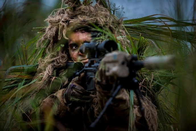An integral part of a sniper's kit, the ghillie suit allows the sniper to blend in with their surroundings and evade detection. alt
