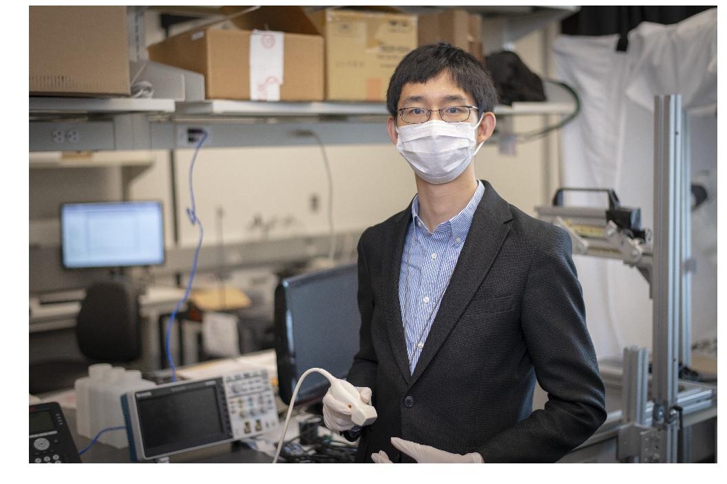 Prof. Haichong Zhang displays ultrasound probe