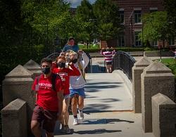 Students cross Earle Bridge alt