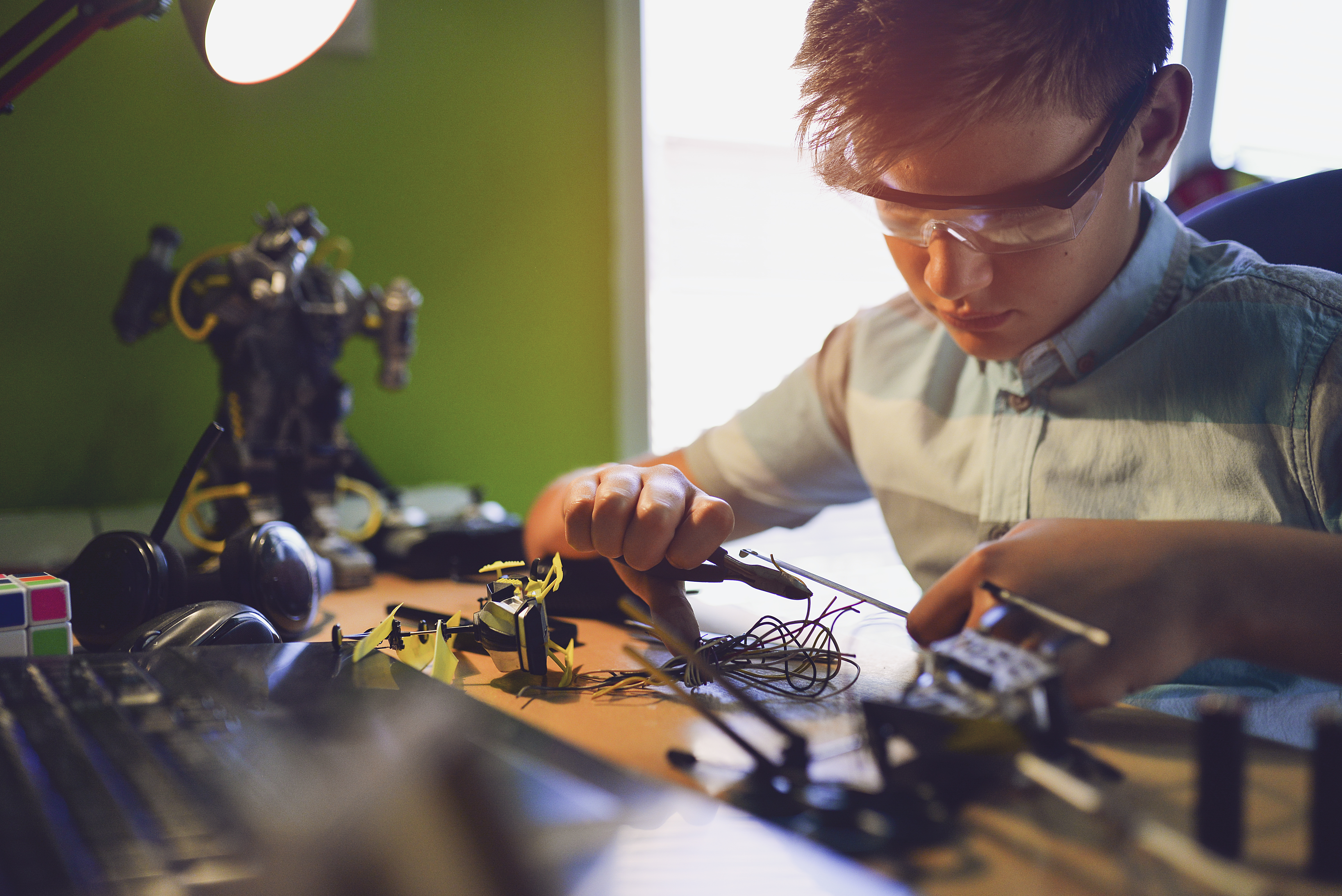 kid working on a robot