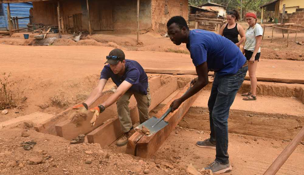 WPI students work with local Ghanaians on a project.