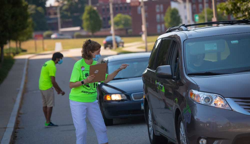 President Leshin directs a car to their respective residence hall during one of 2020's move-in days.