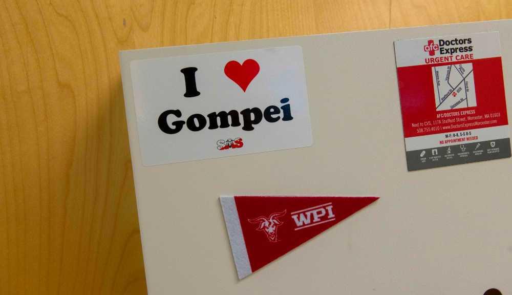 "A sticker that says ""I love Gompei"" underneath a red WPI mini pennant."