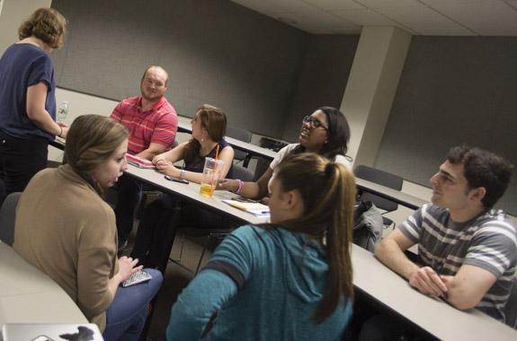 Business undergrads doing team work.