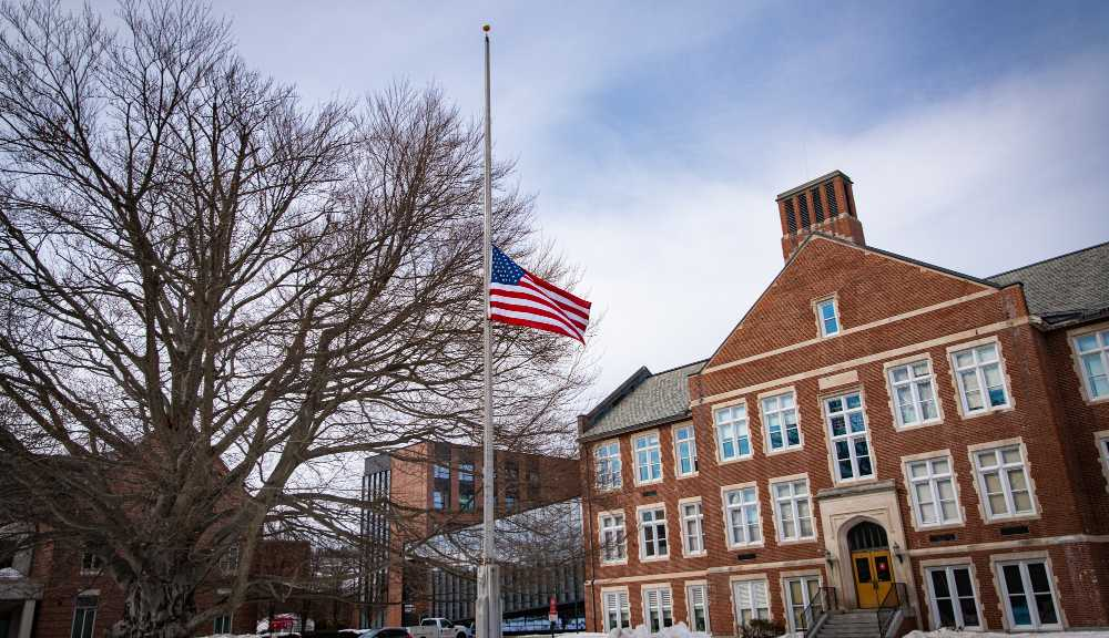 A photo of the flag at the beech tree at half-mast to honor those lost to COVID-19.