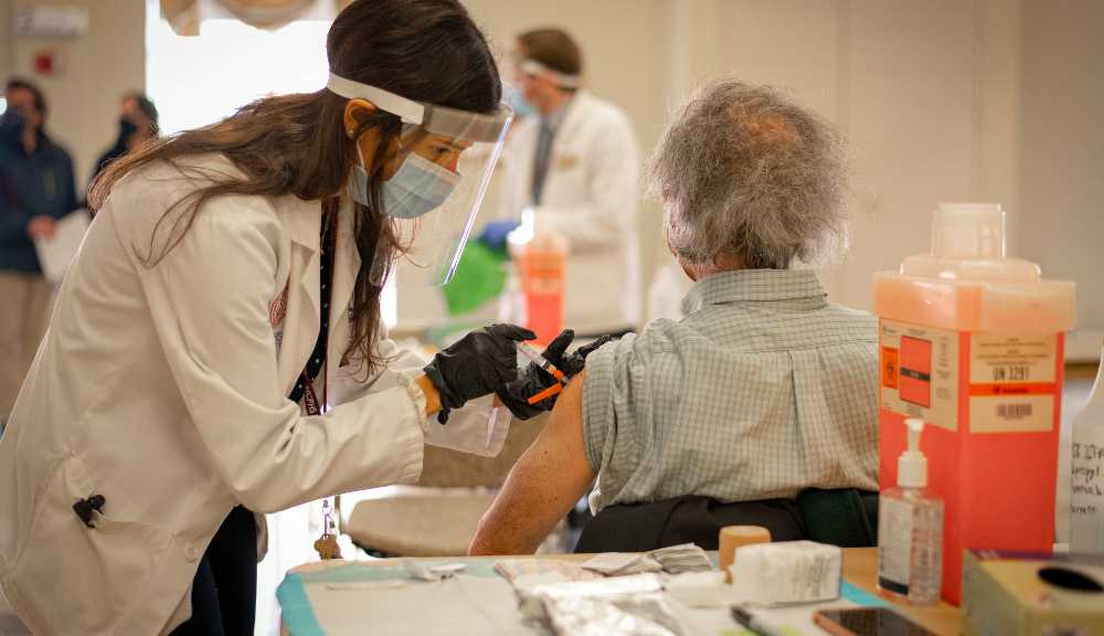 A member of the WPI community receives a first dose of the COVID-19 vaccine.