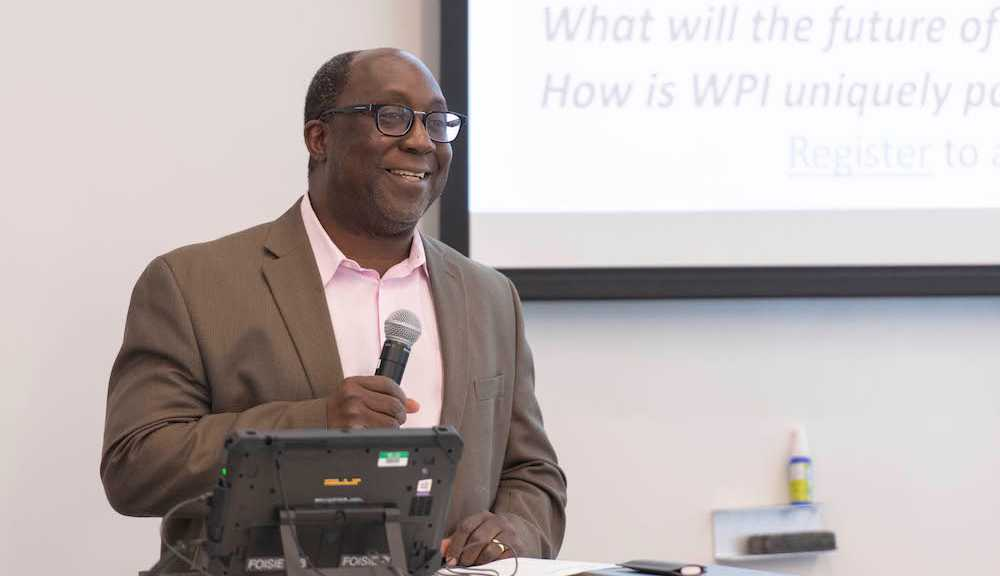 Microphone in hand, Wole Soboyejo delivers an address prior to the COVID-19 pandemic.