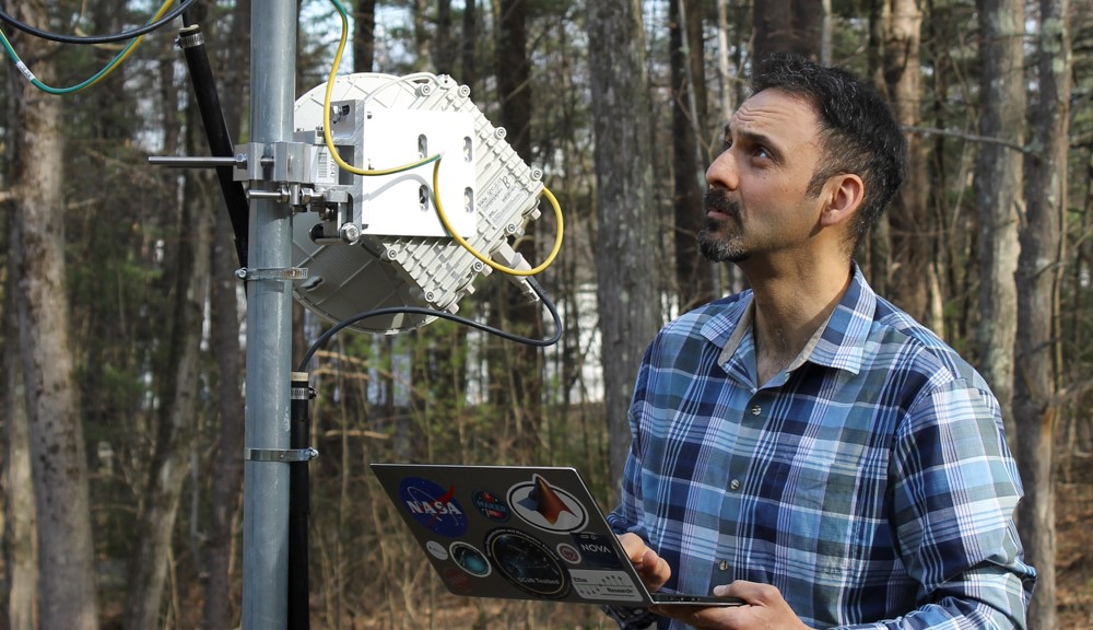 WPI Professor Alex Wyglinski configures a millimeter wave radio unit that forms part of a small-scale research test-bed.